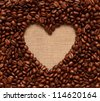 Heart coffee frame made of coffee beans on burlap texture - stock photo