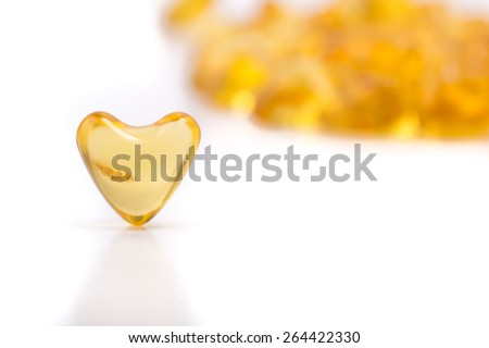 heart color pills of fish oil - stock photo