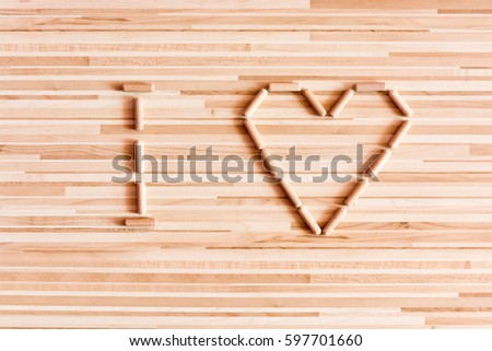 Closeup yellow zinc coated screw isolate stock photo 604907681 heart composed of wooden dowels on wooden background do it yourself needs home improvement solutioingenieria Gallery