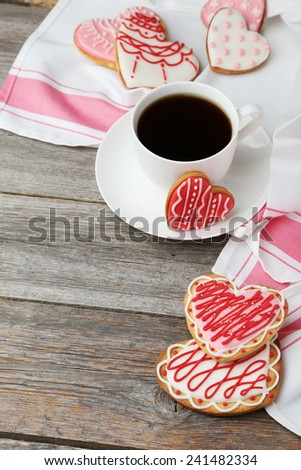 Heart cookies with cup of coffee on grey wooden background - stock photo