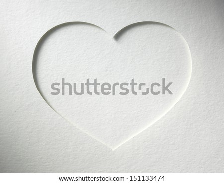 heart cutted from paper lies on the paper background