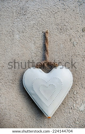heart decoration on stone wall