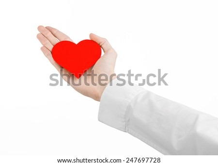 Heart Disease and Health Topic: hand doctor in a white shirt holding a card in the form of a red heart isolated on a white background in studio - stock photo
