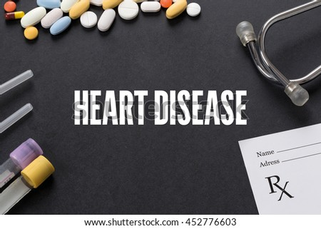 HEART DISEASE written on black background with medication