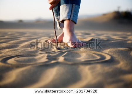 Heart drawing on dry sand - stock photo