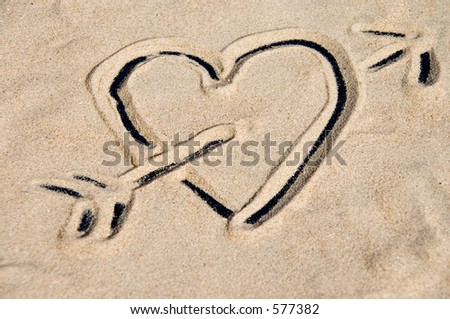 Heart drawn in sand - stock photo