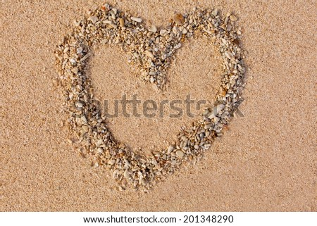 Heart drawn in the sand on the atlantic coast - stock photo