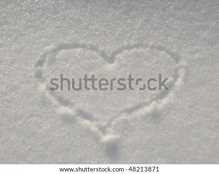 Heart drawn in the snow - stock photo