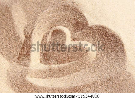 Heart drawn on sand - stock photo