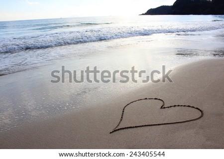 Heart drawn on the beach  - stock photo