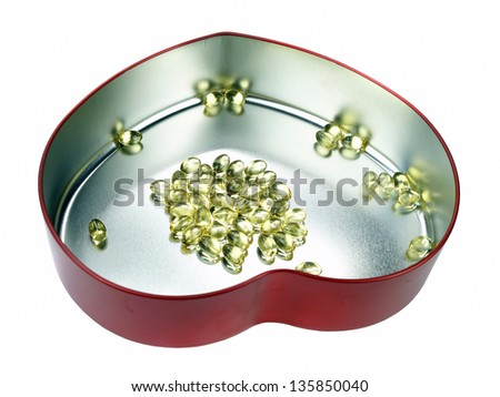 Heart filled with omega 3 - stock photo