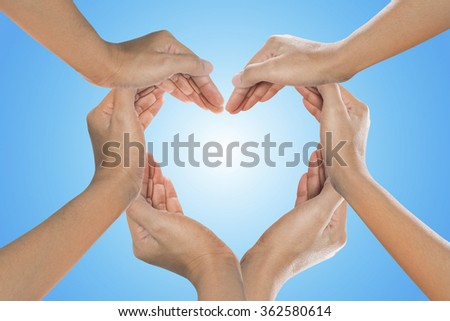Heart formed by  female hands isolated on white