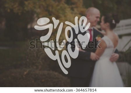 Heart Formed From happy valentine's day Text -Handmade Calligraphy. Bride and groom looking to each other and laughing  - stock photo