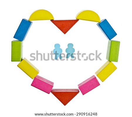 Heart frame  made from colored wooden blocks on a white background - stock photo