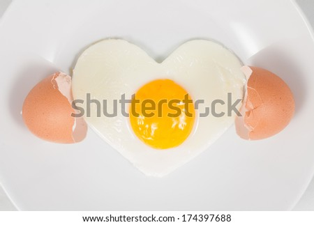 heart fried egg on dish - stock photo