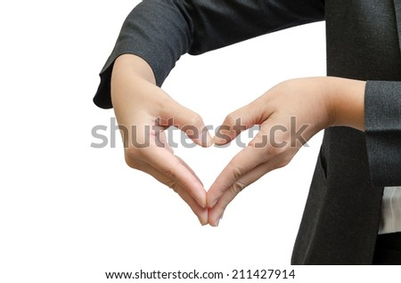 Heart from business people hand isolated on white background - stock photo