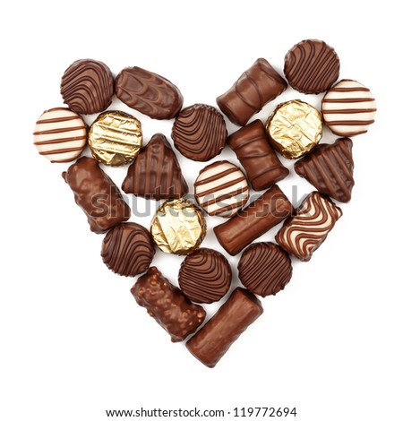 Heart from chocolate candies isolated on white background - stock photo