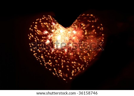 Heart from fireworks on the black sky background