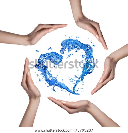 Heart from water splash with human hands isolated on white