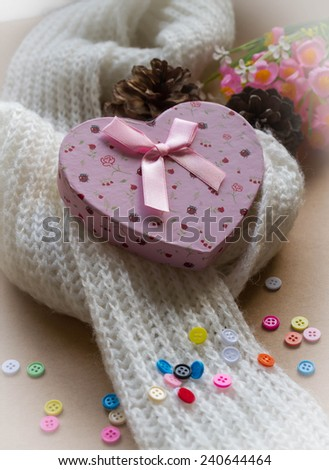 Heart gift box and knitted white  scarf ,Valentine's setting with presents and festive decoration