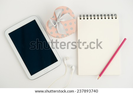 Heart gift box tablet and note book pen on white background - stock photo