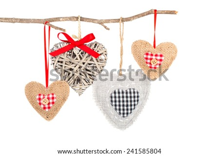 heart hanging on a tree branch, isolated on white background - stock photo