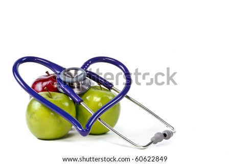 Heart healthy apples with stethoscope and white space for text - stock photo