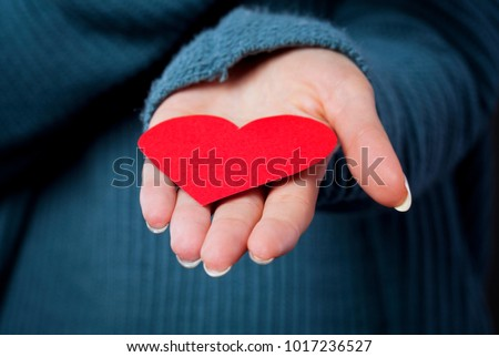 Heart icon on hand. Love concept.Health haert. Valentine`s day