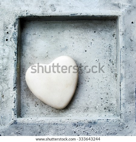 Heart in frame made in stone, valentine background. - stock photo
