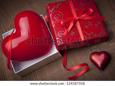 Heart in gift box. Valentines background - stock photo