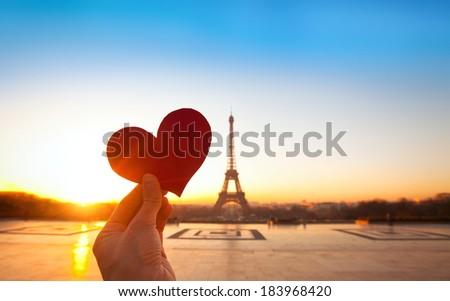 heart in hands, romantic vacations in Paris - stock photo