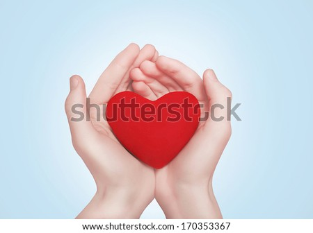 Heart in hands. Valentine's day, romance, love concept