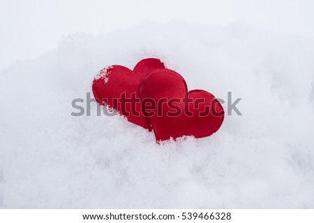 Heart in snow. Congratulation on St. Valentine's Day. Greeting card. Romantic background.