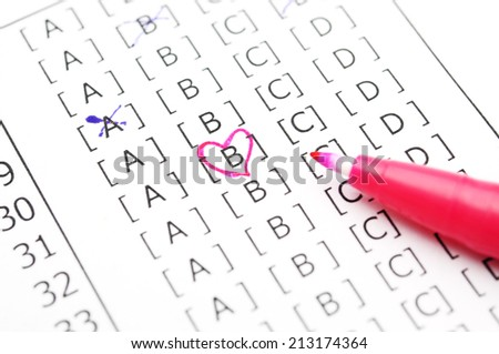 heart in test score sheet with answers  - stock photo