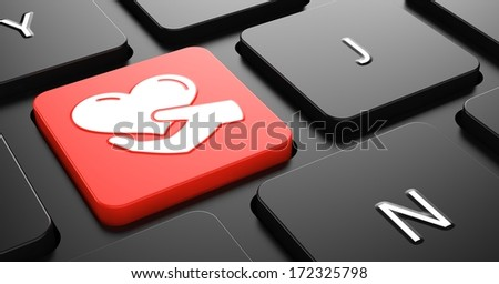 Heart in the Hand Icon - Red Button on Black Computer Keyboard. - stock photo