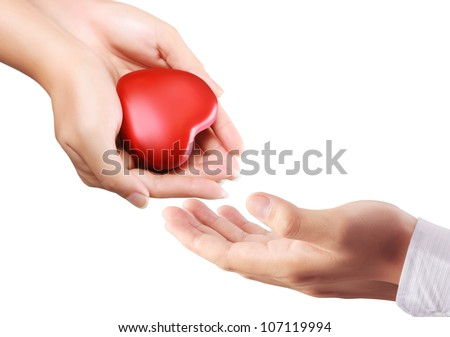 Heart in the hand isolated on white - stock photo