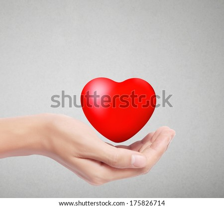 Heart in the hands isolated