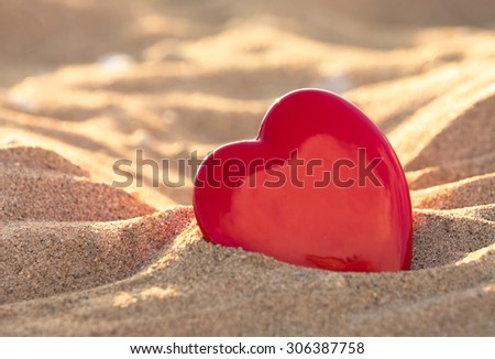 Heart in the sand.  - stock photo