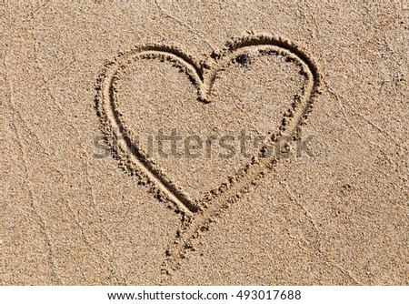 Heart in the sand on the beach.