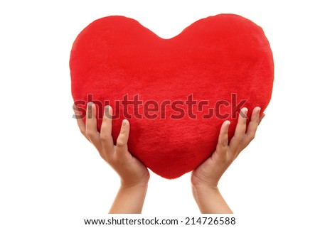 Heart in woman's hands against white background. Closeup.
