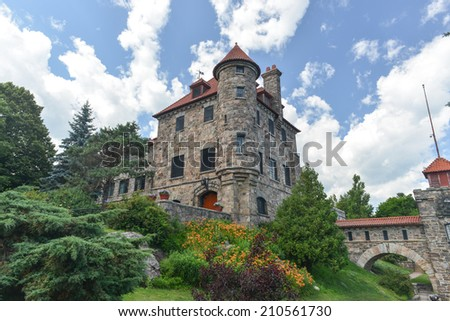 HEART ISLAND, NEW YORK - JULY 5, 2014: Singer Castle located on Dark Island in the St. Lawrence Seaway, New York, USA.