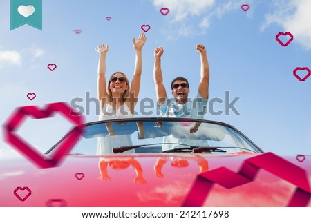 heart label against crazy couple standing in red cabriolet - stock photo