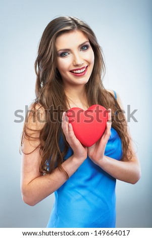 Heart, love symbol young happy woman hold. Isolated on studio background female model.