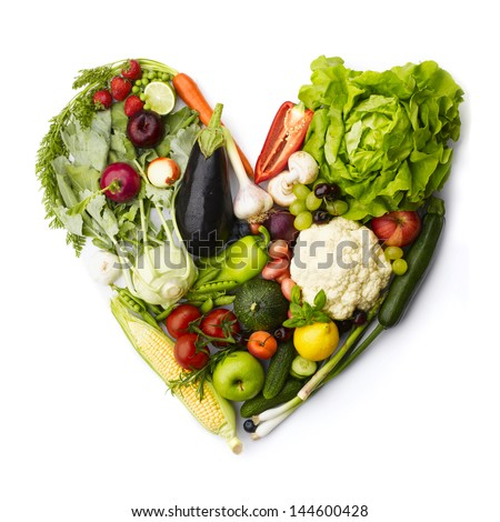 Heart made by various vegetables and fruits isolated on white. - stock photo