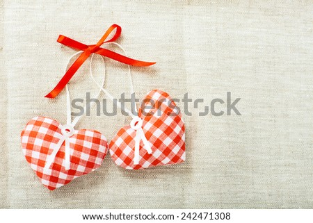 Heart made of cloth in red cell handmade Valentines Day on the background of vintage linen fabric texture. Tag labeling.  - stock photo