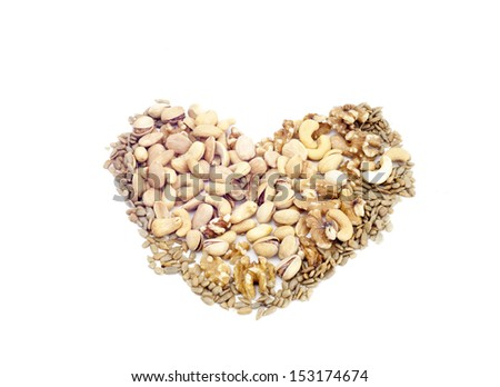 Heart made of dried fruits and nuts isolated on white - stock photo