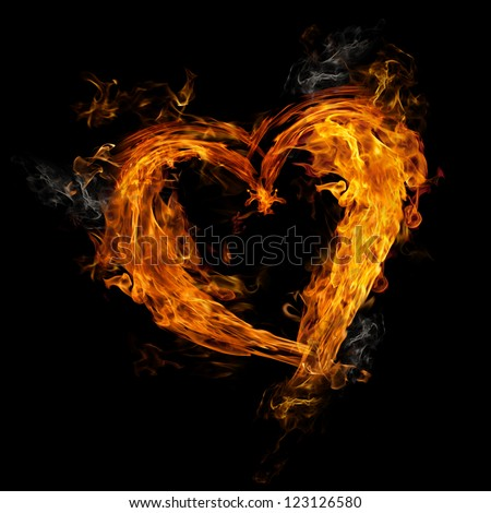 Heart made of fire on black background - stock photo