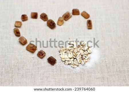 heart made of lump sugar with oatmeal and white sugar, love oatmeal sign - stock photo