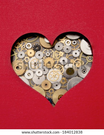 Heart made out of gears and cogs - stock photo