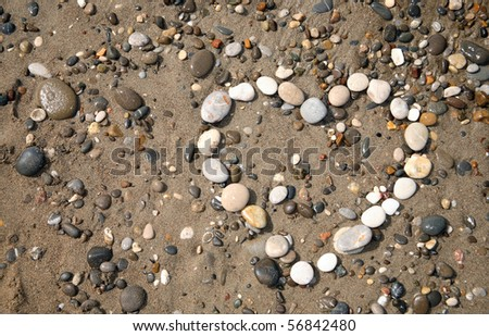 heart made with pebbles on the beach - stock photo